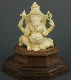 """INDIAN IVORY CARVING OF GANESH. 2 1/2""""h on a 1 1/4""""h wood plinth."""