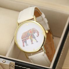 A gold-and-cream analog elephant watch that will become any fashion lover's go-to accessory. | 42 Gifts Every Elephant Lover Will Want To Get This Year