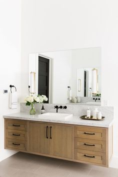 Natural Wood Floating Vanity and matte black fixtures || Studio McGee.jpg
