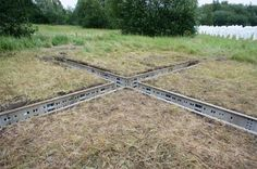 "German street artist EVOL has constructed this urban ""X"" in a field outside of Hamburg as part of the upcoming MS Dockville music and art festival."