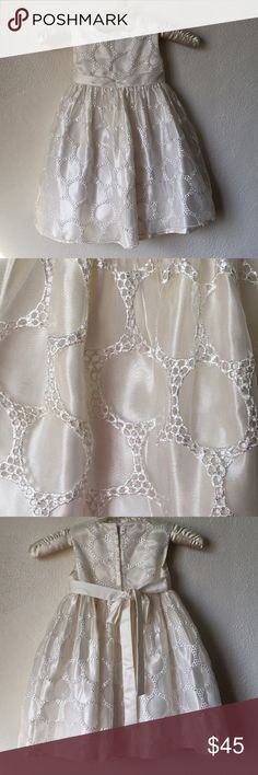 Beautiful Ivory Formal Dress EUC my daughter only wore it once for a wedding.  Beautiful lace circle details. Zipper back and tie around waist. Ivory color American Princess Dresses Formal