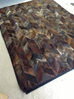Chocolate Patchwork Cowhide Rug / Hair on Cow Leather Rug. $586.00, via Etsy.