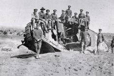 British and Australian soldiers on the wrecked British Mark I tank, 'War Baby', outside Gaza, 1918.