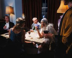 Picture of adults playing a game while wearing costumes - Frank Herholdt/The Image Bank/Getty Images