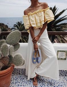 Wide leg pants with a fitted waist balance a flowing boho top. | Vacation Outfits that Make the Best Instagram Pics