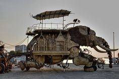 """The Sultan's Elephant"" - Made of 45 tons of reclaimed wood and steel, this giant, mechanical elephant was designed by Francois Delarozière, and created by France's Royal de Luxe theater company for a show based on a Jules Verne story about a time-traveling sultan, his elephant and the girl of his dreams. - see 1800recycling.com"