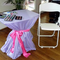 Use TV tray tables to create the mani, hair and make up stations