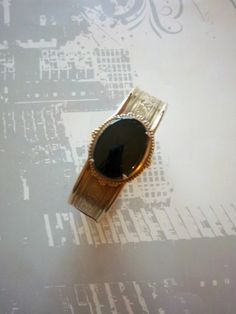 Unique piece from yesteryear! Vintage Brass Victorian Bangle Bracelet Etched Onyx via Once Upon A Gem. Click on the image to see more!
