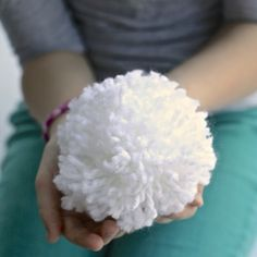 Never Melt Snowballs - super cute idea for indoor snowball fights!.  Better yet, it shows you how to make a Pom Pom using your hand to wrap the yarn around !!!