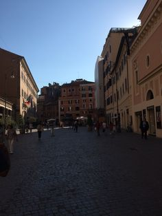 Walking by one of the squares in Rome
