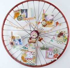 Look how she used an old bicycle wheel to display photos and small layouts. This would be so cute changed out for the different seasons.