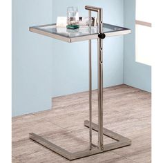 Discover practicality and polish with this modern side table. Sleek and clean, this table features a U-shaped chrome base with a coordinating square glass table top. The table top is adjustable in height for customized use.