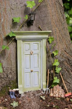 Every tree in every neighborhood needs one! Fairy Doors in the Forest via Kate's Creative Space
