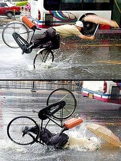 Bicycle accident in London carrying open umbrella