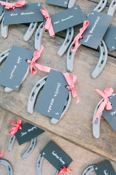 I'm in rustic wedding heaven with these adorable horseshoe escort cards!