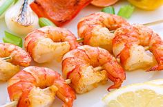 Garlic lemon shrimp skewers  Shrimp is one of the easiest, and healthiest, appetizers you can serve! There are fewer than 10 calories per medium shrimp, so even paired with cocktail sauce you still have a very skinny appetizer idea. This garlic and lemon shrimp is simple to make a day or two ahead of time for stress-free party prep.