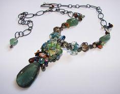 beautiful combination of artisan lampwork, gemstones and metal. As always by Crysallis Creations.