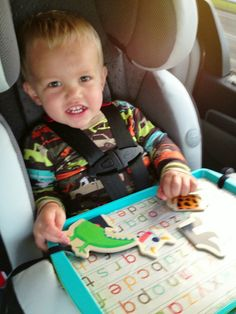When we were prepping for our trip to Gulf Shores, I'd be lying if I said I wasn't terrified of the idea of being in the car all day with small children. It seriously scared the crap o… Car Seat Tray, Car Seats, List Of Activities, Toddler Activities, Travel Activities, Travel Tray For Kids, Road Trip With Kids, Toddler Travel, Car Travel