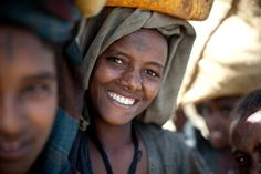 A girl in Agam Minch, Ethiopia, carries water home to her family. Her village uses a charity: water well for their drinking water.