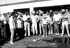 #JamesGarner running a radio controlled car in front of fans, mechanics and fellow racers.