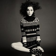 Annie Clark is wearing an embroidered jacquard jumper by PUCCI and black suede shoes by MANOLO BLAHNIK. In The Gentlewoman