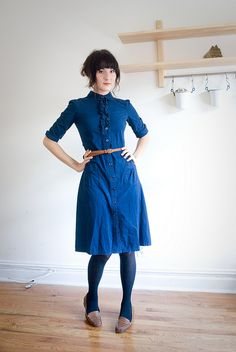 blue pocket dress with subtle ruffle detail. prairie vintage charm.