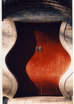 Big red Chinese door inside a hutong in Beijing