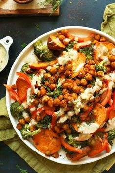 A satisfying, plant-rich entrée or side with roasted broccoli, sweet potato, and chickpeas. Topped with a creamy 4-ingredient garlic dill sauce.
