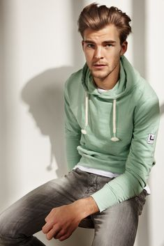 Shop this look for $57: http://lookastic.com/men/looks/white-crew-neck-t-shirt-and-grey-jeans-and-mint-hoodie/1771 — White Crew-neck T-shirt — Grey Jeans — Mint Hoodie