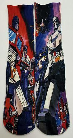 """Good Vs. Bad"" Transformers Mid-Calf Socks Adult Unisex- One size Fits Most  Order Online: http://www.getnitinco.com/#!product/prd1/4243464175/good-versus-bad-socks"