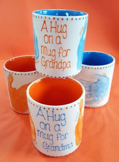 Hug on a Mug for Grandpa or Grandma (or Mummy/Daddy/Auntie/Uncle) Children's hand prints either side of a mug looks like they are hugging the mug.