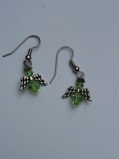 Green, Genuine Swarovski Bicone Angel Earrings  $14.99 These lovely green, genuine Swarovski bicone Angel earrings remind us that our Angels are always with us. This is the color of the 4th/Heart chakra. Unconditional love.  Handmade with Love in the USA