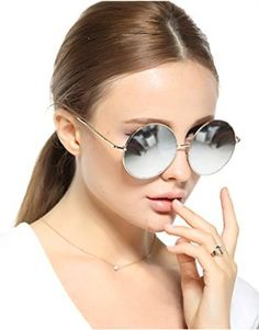 2016 Sexy Retro Oversized Large Round Sunglasses For Women Rainbow Mirrored Trendy Sunglasses for Women are sunglasses that are heart shaped or otherwise oversized.  You will appreciate these will help elevate any fashion forward fashionista.  In fact, I like to own several pair of funky sunglasses so I can match or at best compliment my outfit.  Regardless several of these trendy, chic and funky sunglasses belong in your wardrobe.