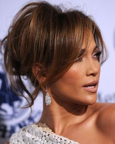 Great spring hair......Jennifer Lopez Hairstyles: Modern Loose Bun for Any Face Shape