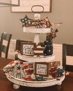 July Tiered Tray decoration ideas to glam up your home in Patriotic Spirit - Hike n Dip - - Make your July decoration even more special with the best July Tiered tray decoration ideas. These Patriotic Day decorations are easy to do. Fourth Of July Decor, 4th Of July Decorations, July 4th, Table Decorations, 3 Tier Stand, Tiered Stand, Tiered Server, Seasonal Decor, Holiday Decor