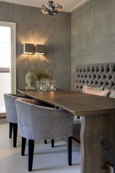 chic dining room, banquette seating, greige, monochromatic wallpapered walls.