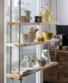 .shelves made of boards and rope in kitchen window...I would like to make a variation of this..maybe more modern and brightly colored