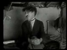 Smile written by Charlie Chaplin and performed by Michael Jackson.  This video should bring a smile to your face