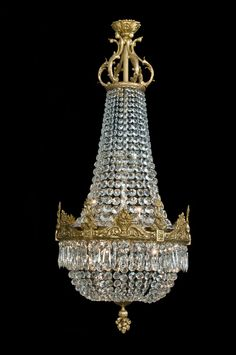 A Fine Gilt-Bronze Cut-Glass Tent and Bag Chandelier With Finely Cast Entwined Dolphins  French, Circa 1900.