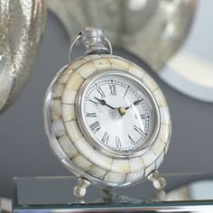 Savin Table Clock | Crafted from iridescent capiz shells, the footed Savin Clock brings a luminous touch to any surface.