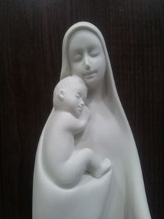 This soothing St.Mary is situated on my desk.  I'm looking holly mom any time.