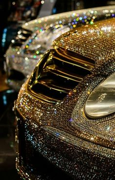 Encrusted! Two cars covered in diamond and gold bling!