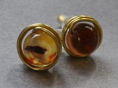 Simple, yet beautifully shimmering earrings with orange/brown Agates, framed with brass wire!    Handmade!    silicone connectors ensure a secure hold
