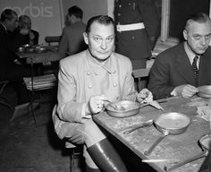 """Goering Eating Lunch - U779959ACME - Rights Managed - Stock Photo - Corbis. Original caption:Goering Lunches at Trial. Nuremberg, Germany: Hermann Goering seems startled by the photographer's flash as he lunches """"a la American Army"""" during the trial in the Palace of Justice here. December 5, 1945."""