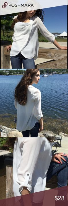 """Mid Sleeve Blouse White mid-sleeve blouse. Slight Hi Lo style. Size small. 100% polyester. Semi sheer. Front length approx 25"""". Back length approx 27.5"""". Arm length approx 18"""" Bust approx 41"""" iConcepta Boutique Tops Blouses"""
