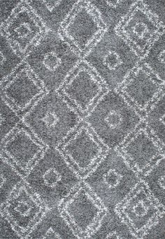 Bring the comfort of this machine-woven, 100 percent polypropylene easy shag rug to your home. Fuse the traditional and contemporary, while adding depth and beauty to your décor with geometric designs and comfortable feel to your tired feet.