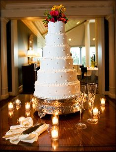 6 tiered white cake with polka dots - Photo by Jason