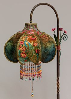 #1603 Beautiful and unusual Art Nouveau style bridge lamp with tole flowers has been hand painted and holds a Peacock & Roses silk and beaded shade.