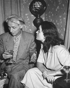 """""""Max Ernst & Dorothea Tanning sipping champagne"""" Photo by Eliot Elisofon (1942) LIFE Magazine"""