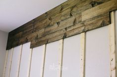 At the hardware store or at home cut sheets of four feet by 8 feet pieces of plywood into long strips. Either have all the strips cut one width such as four to six inches wide and the 8 feet long. In blue wood planked accent wall Carrie used two different sized boards, her wall used eight boards that are six inches wide and four boards that are eight inches wide. It is possible to use another type of wood board in replacement of plywood, but plywood is suggested for this proj